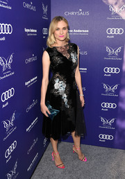 Diane Kruger added an extra pop of color with a metallic blue clutch by Anya Hindmarch.