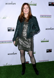 Dana Delany toned down the shimmer with a teal leather jacket.