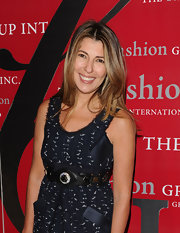 Nina Garcia complemented her dress with a bejeweled black leather belt at the Rising Star Awards.