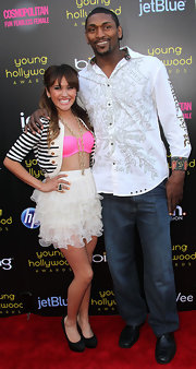 Metta World Peace looked fun and snazzy in a white print button-down.