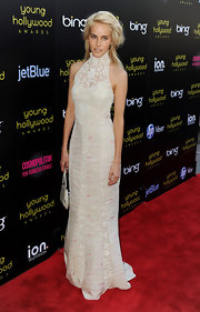 Isabel Lucas was prairie chic in this lace and faint floral gown by Ralph Lauren. The seemingly conservative frock was given a slight hint of sexiness with a see-through panel and fitted silhouette.