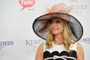 Mira Sorvino accessorized with a wide-brimmed mesh hat at the Kentucky Derby.