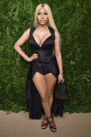 Nicki Minaj complemented her outfit with black crisscross-strap sandals.