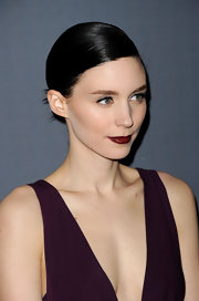 Rooney Mara wore her hair in a sleek updo featuring a loose bun at the 14th Annual Costume Designers Guild Awards.