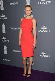 Amber Valletta paired her coral frock with black sandals.