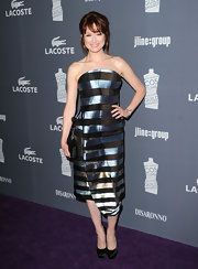 Ellie Kemper wore this iridescent striped strapless dress to the Costume Designers Guild Awards.