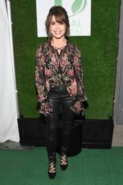 Paula Abdul attended the Global Green pre-Oscar party wearing a floral peasant blouse.