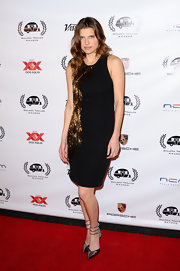 Lake Bell chose this sleeveless black dress with elegant gold embellishments for her look at the Golden Trailer Awards.