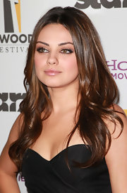 Mila Kunis has the smoky eye down.  Her gray liner fades beautifully into her blush pink shadow.