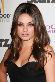 Mila Kunis vamped up her look with voluminous center part curls while attending the 14th Annual Hollywood Awards Gala.