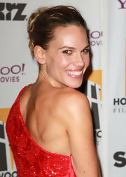 In an age when some starlets suffer from overstyling, Hilary Swank was the picture of youthful glamour in a messy bun at the Hollywood Awards.