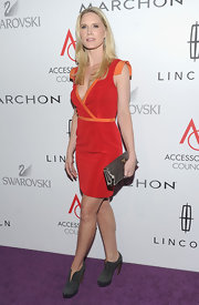 Stephanie March topped off her vibrant red carpet frock with gray suede ankle platform boots.