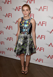Kiernan Shipka sealed off her look with a pair of Jimmy Choo strappy sandals.