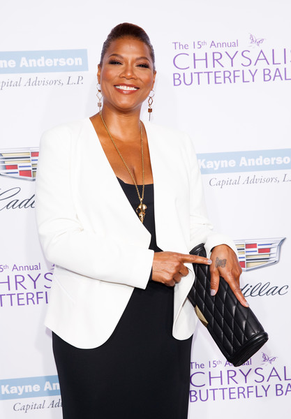 Queen Latifah accessorized with a quilted black leather clutch at the Chrysalis Butterfly Ball.