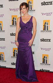 Sarah Rue showed off her hourglass figure in a purple taffeta gown at the Hollywood Film Awards Gala.