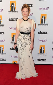 Andrea Riseborough looked lovely on the red carpet in a cream embroidered silk evening dress.