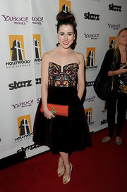 Genevieve Farrell wore a strapless cocktail dress with a velvet skirt and beaded bodice for the Hollywood Film Awards.