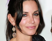 Courtney Cox showed off her gemstone earrings which she paired with a loose ponytail.