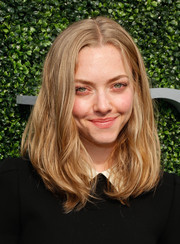 Amanda Seyfried attended the USTA opening night gala wearing a tousled center-parted 'do.