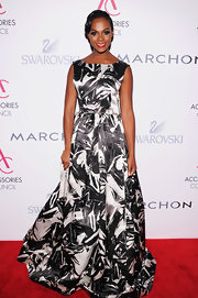 Tika was the most glamorous of the night in her black-and-white print ball gown.