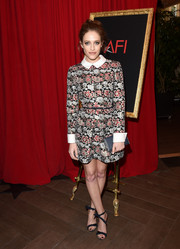 Carly Chaikin looked sophisticated in a floral printed above-the-knee frock with white collared and sleeved piping.