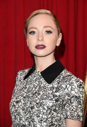 Portia Doubleday vamped up her look with a berry lip at the AFI Awards.