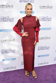 Molly Sims went for a modern vibe at the Chrysalis Butterfly Ball in a two-tone Julianna Bass column dress with shoulder cutouts and layered sleeves.
