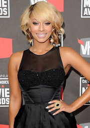 Keri Hilson paired her sparkling sheer dress with a decadent gold and black cocktail ring.