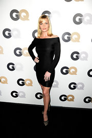 Jaime Pressly donned a figure-flatting black dress. She paired the look with lacy platform pumps.