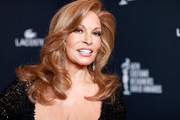Raquel Welch looked ageless and gorgeous with her bouncy waves and flawless complexion during the Costume Designers Guild Awards.