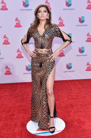 Blanca Blanco struck a seductive pose on the Latin Grammys red carpet wearing a sequined gown with a thigh-baring slit.