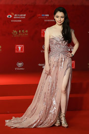 Vivian Hsu wore this light pink gown that featured and illusion neck, an embellished skirt, and a thigh-high front slit.