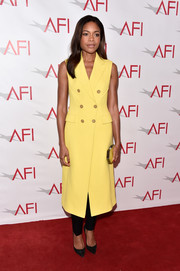 Naomie Harris looked sharp in a yellow vest dress by 3.1 Phillip Lim at the AFI Awards.