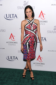 Eva Chen teamed her electic dress with classic black peep-toes with triple ankle straps.