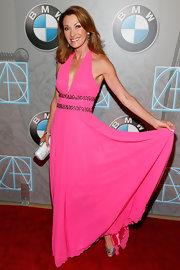 Jane looked splendid in this hot pink halter gown with a beaded waistline.