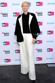 Tilda Swinton maintained her signature androgynous appeal in a wholly modern black0and-white suit with a two-tone cropped sleeve jacket.