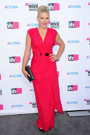 A radiant Busy Philipps matched the subtle black detail of her hot pink dress with a gleaming clutch.