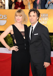 Sunrise arrived at the SAG Awards in a daring low-cut gown with lace bandeau.