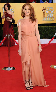 Jayma Mays spiced up her peach gown with strappy metallic Glamour platform sandals.