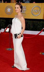 Natalie Portman carried a sophisticated black satin Pilgrim clutch with an elaborate crystal clasp.