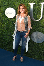 Shania Twain teamed her shirt with a pair of bedazzled skinny jeans.
