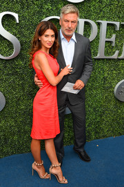 Hilaria Baldwin styled her dress with a pair of nude Alaia Bomb sandals.