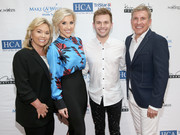 Savanna Chrisley paired a blue foliage-print blouse with a black pencil skirt for the Waiting for Wishes celebrity dinner.
