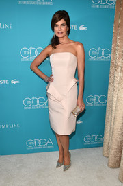 Betsy Brandt went for minimalist elegance in a white Rubin Singer peplum strapless dress during the Costume Designers Guild Awards.