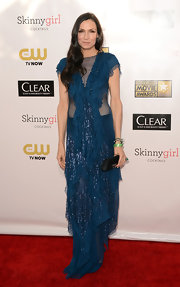 Famke was the most uniquely dressed of the night in this skin revealing mesh ruffled teal creation.