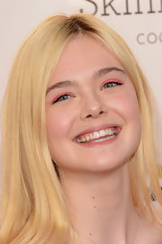 Elle Fanning had so much fun on the 2013 Critics' Choice Awards red carpet! Not only was she super-smiley, she channeled a playful vibe with this bright pink shadow.