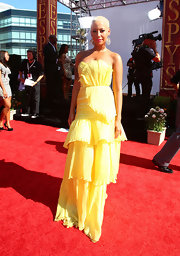 Amber stood out vibrant yellow, tiered evening dress.