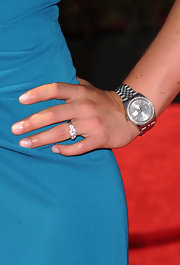Lindsey walked the red carpet in a teal evening gown with silver accessories, including a classic bracelet watch.