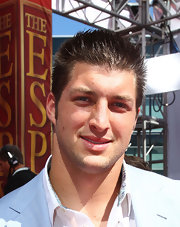 Tim Tebow showed off his spiked haircut while hitting the ESPY Awards.