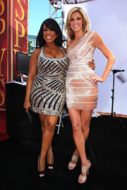 Niecy sparkled in a glitzy, black and silver mini dress with platform pumps.